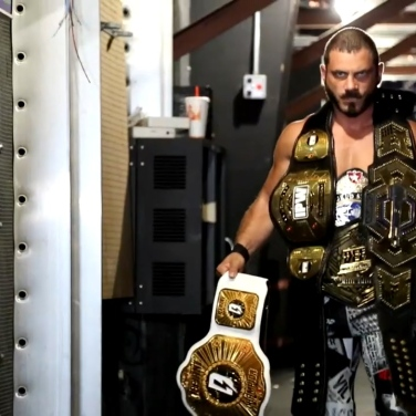 """The Belt Collector"", defending iMPACT World Champion, Austin Aries"