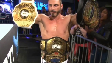 Impact Champion Austin Aries, adorned with all of his various top titles