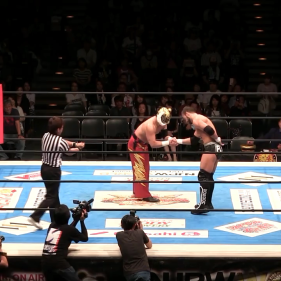 A show of respect between Tiger Mask and Flip Gordon before their match (editor's note: Tiger Mask is the one with the mask that looks like a tiger)