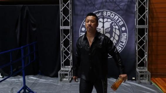 Yoshinobu Kanemaru, with his trust bottle of /something/ at his side (Whiskey? It's probably whiskey.)