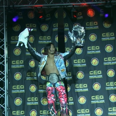 The three most important things to Hiromu Takahashi: (from right), his BOSJ trophy, his IWGP Junior Heavyweight Championship... and his cat.