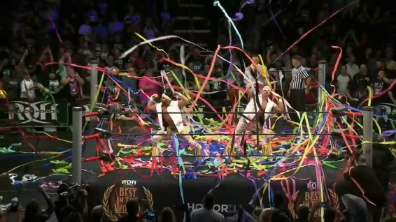 The Young Bucks, showered with streamers (that's Nick on the right, under there somewhere)