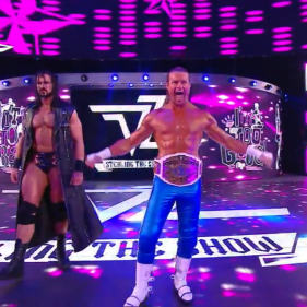 Champion Dolph Ziggler, flanked by his better-in-every-way bodyguard, Drew McIntyre