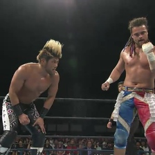 SANADA contemplates how to avoid a wicked left hand from Juice Robinson