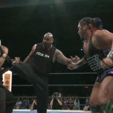 Bad Luck Fale tries to get his leg free from the referee, as EVIL loads up a superkick