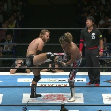 Hangman Page and Hiroshi Tanahashi telling the other to put their leg down
