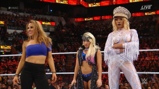 Zelda Bliss (center), flanked by Mickie James and Alicia Fox