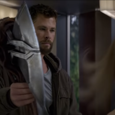 A very angry God of Thunder (Chris Hemsworth) stares down Captain Marvel (Brie Larson)