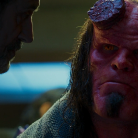 Hellboy (David Harbour) and his adoptive father, Trevor (Ian McShane)