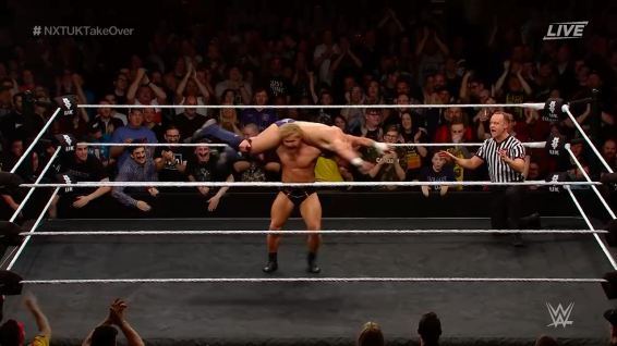 Tyler Bate hits a HUGE aeroplane spin on Jordan Devlin, and the crowd rises to their feet