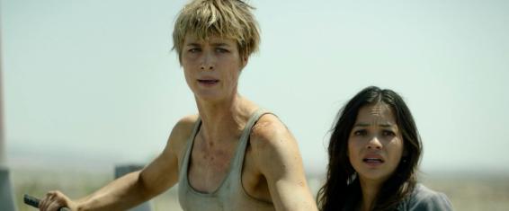 Grace (Mackenzie Davis) protects Dani (Natalia Reyes).