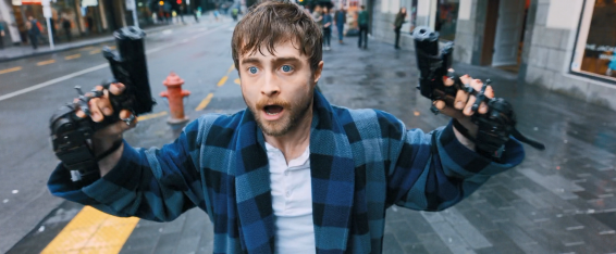 Miles (Daniel Radcliffe), wielding guns... akimbo. Get it? That's the name of the movie.