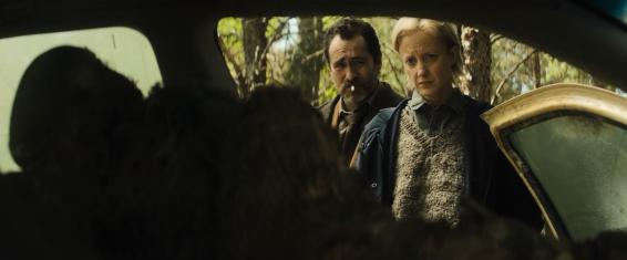 Detective Muldoon (Andrea Riseborough) and Detective Goodman (Demián Bichir) investigate a grisly murder scene