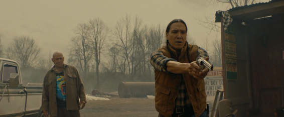Gisigu (Goeman) watching as Traylor (Greyeyes) does what needs to be done