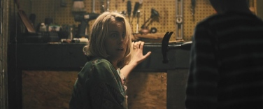 Sarah (Taylor Schilling) and a well utilised tool bench