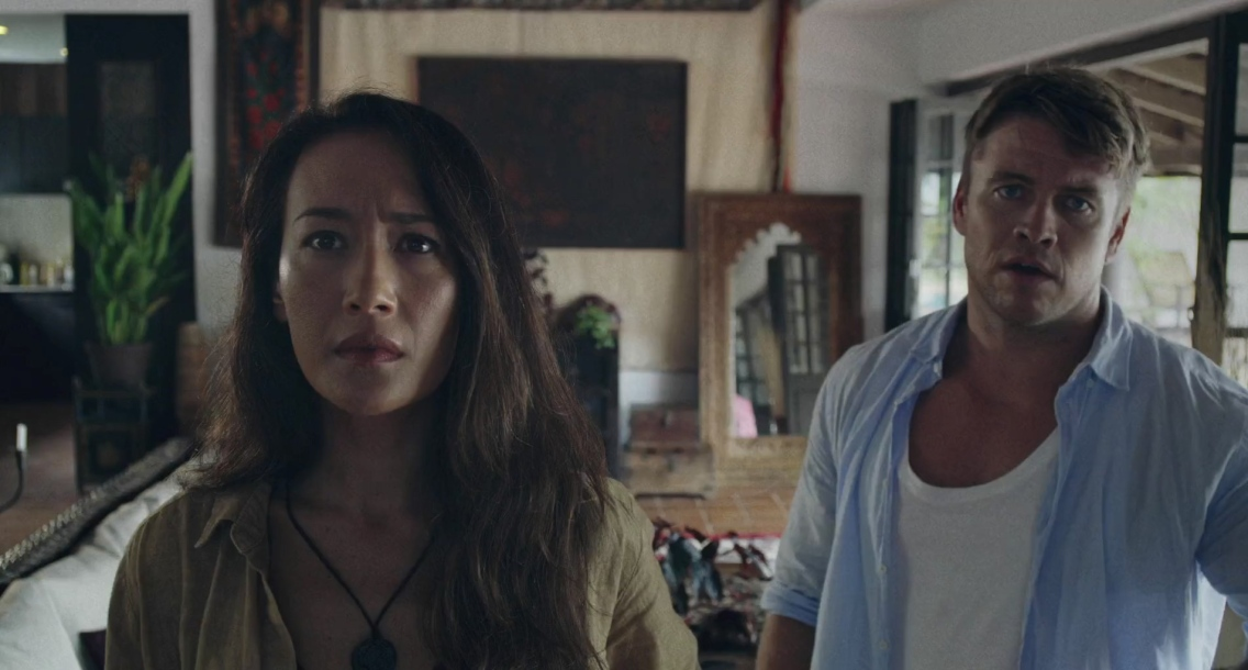 Christine and Neil Oliver (Maggie Q, and Luke Hemsworth) not at all impressed with what they're watching