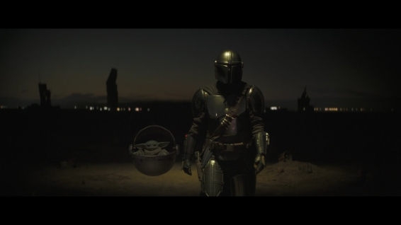 The Child, accompanied by the titular Mandalorian (Pedro Pascal)