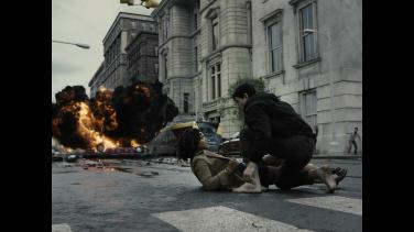 Barry Allen (Ezra Miller) rescues Iris West (Kiersey Clemons)